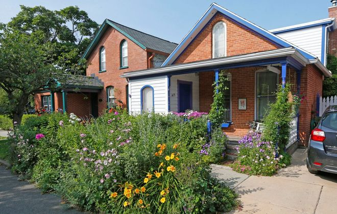 Ellie Dorritie's cottage garden on Summer Street  is a style visitors will see on Garden Walk Buffalo (July 27-28) and other walks and tours. (Robert Kirkham/Buffalo News)