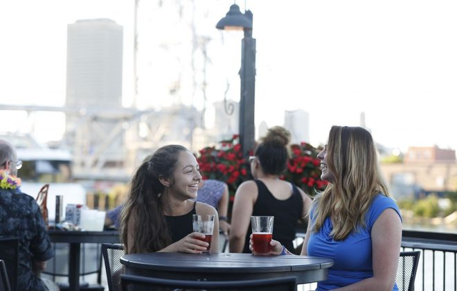 Cait Smith, left, and Kara Lash, of Rochester, enjoy a a beer on the patio at Buffalo RiverWorks. (Sharon Cantillon/Buffalo News)