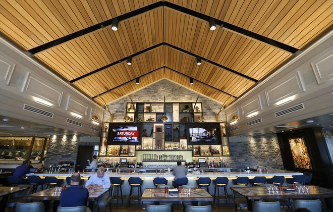 The bar area in Jazzboline, the new restaurant associated with Reikart House. (Mark Mulville/Buffalo News)