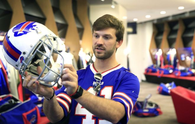 NASCAR driver Daniel Suarez looks at a Buffalo Bills helmet during a tour of the ADPRO Sports Training Center on Monday, July 15, 2019. (Harry Scull Jr./Buffalo News)