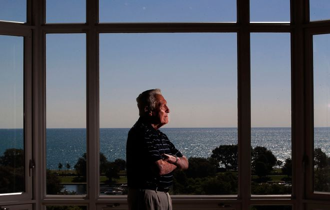 Marv Levy stands in his Chicago home overlooking Lake Michigan on Friday, July 12, 2019. (Harry Scull Jr./Buffalo News)
