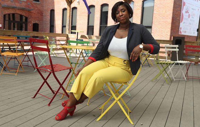 Yolanda Fields, chairwoman of Garden Walk Buffalo, wears a favorite outfit for Fashion Friday, photographed at Larkinville. (John Hickey/Buffalo News)