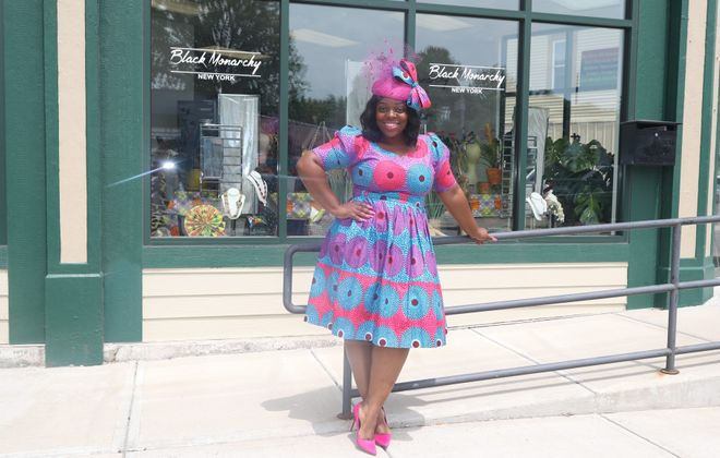 Phylicia Dove wears a favorite outfit in front of her boutique, Black Monarchy. (John Hickey/Buffalo News)