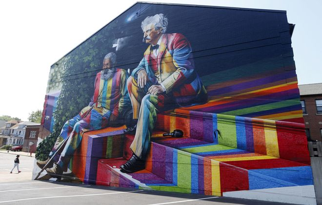 Eduardo Kobra's mural depicting Mark Twain and his friend, John Lewis, has been wildly popular with pubic art fan s of all ages. (Mark Mulville/Buffalo News)