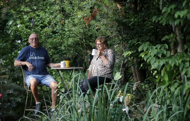 Ron and Marcia  Panzarella in the garden of their home in North Buffalo. Their garden is part of the Northwest Buffalo Tour of Gardens scheduled for Aug. 2 and 3.        (Mark Mulville/Buffalo News)