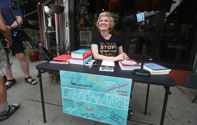 """Ellen Jovin at her """"grammar table"""" outside Caffe Aroma, at Bidwell Parkway and Elmwood Avenue, on Sunday. (John Hickey/Buffalo News)"""