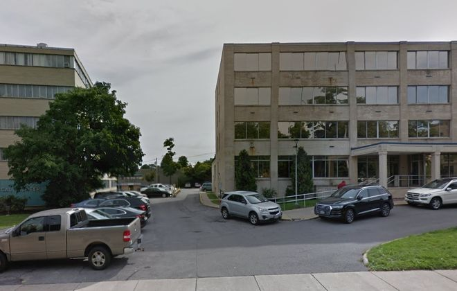 The parking ramp at 1277 Delaware Avenue is tucked behind the office building at 1275 Delaware, shown in front on the left. (Google)
