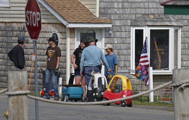 "A film crew is in Olcott preparing for shooting on the movie ""A Quiet Place 2."" Set dressers were busy decorating the exteriors of the cottages along the lakefront with props and distressed items. (Robert Kirkham/Buffalo News)"