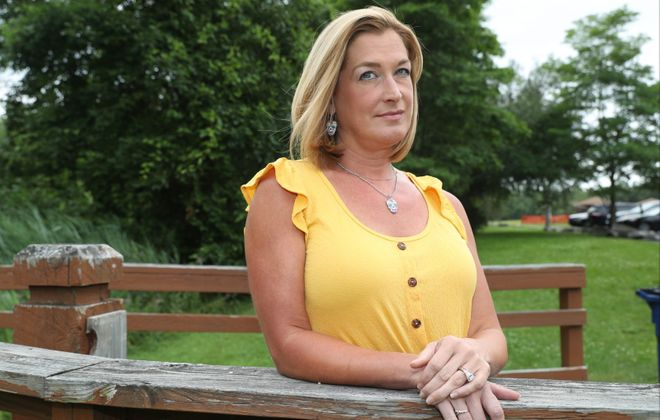 Adrienne Sayers has been fired by the Niagara Falls School District for allegedly violating a requirement that teachers reside in Niagara Falls. (James P. McCoy/Buffalo News)