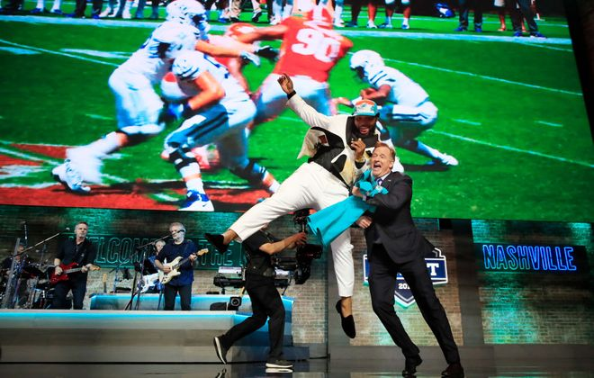 Christian Wilkins of Clemson celebrates with NFL Commissioner Roger Goodell after being chosen #13 overall by the Miami Dolphins during the first round of the 2019 NFL Draft on April 25, 2019 in Nashville, Tennessee. (Photo by Andy Lyons/Getty Images)
