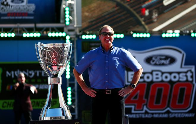 Former NASCAR driver Rusty Wallace stands with the Monster Energy NASCAR Cup Series trophy. (Sarah Crabill/Getty Images)