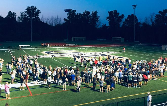 A memorial for coach John Faller drew a large crowd to Sweet Home Tuff Complex on Friday night. (Jonah Bronstein/Staff)