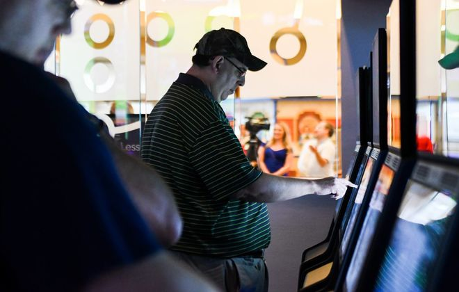 A patron uses a self-service betting terminal during the grand opening of FanDuel, New York State's first official sportsbook, at Tioga Downs Casino Resort in Nichols, N.Y., Friday, July 19, 2019. (Heather Ainsworth/Special to The News)