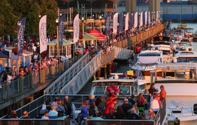 Crowds gather on foot and on water for one of Canalside's Independence Day celebrations. (Derek Gee/News file photo)