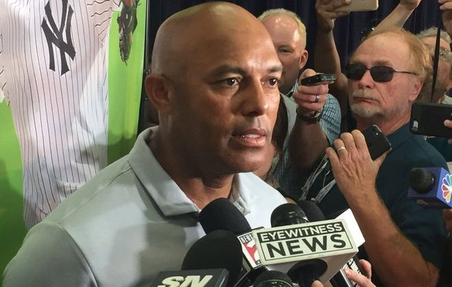 Mariano Rivera listens to a reporter's question during his media session Saturday in Cooperstown (Mike Harrington/Buffalo News).