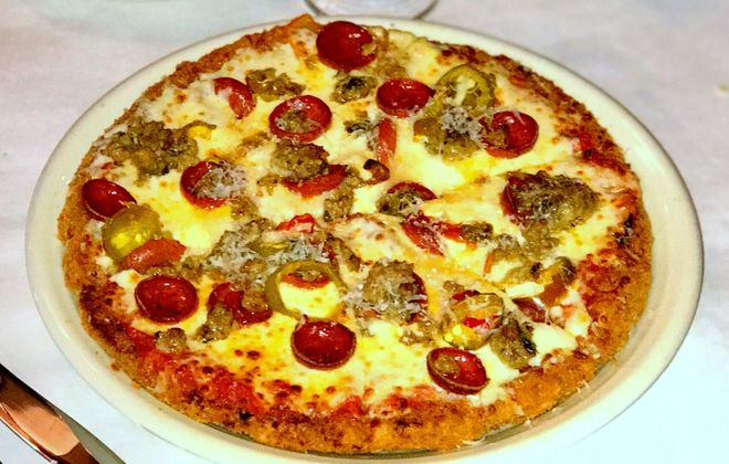 Lackawanna's Mulberry restaurant has a pizza-sized chicken Parm, here topped with pepperoni, hot cherry peppers and sausage, on its new menu. (Photo courtesy of Mulberry)