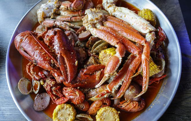 Dungeness crab legs, lobster and king crab amid a myriad of succulent Cajun seafood, sausage, potatoes and corn at Storming Crab. (Derek Gee/Buffalo News)