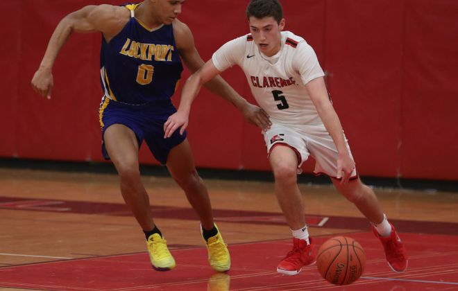 Clarence's River Reinhardt (5) and Lockport's  Maik Brooks were honored by their respective leagues   (John Hickey/Buffalo News)