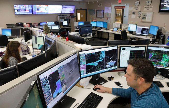 Meteorologist Michael Fries tracks a wide variety of data sets to predict the weather at the National Weather Service office in Cheektowaga. (Derek Gee/Buffalo News)