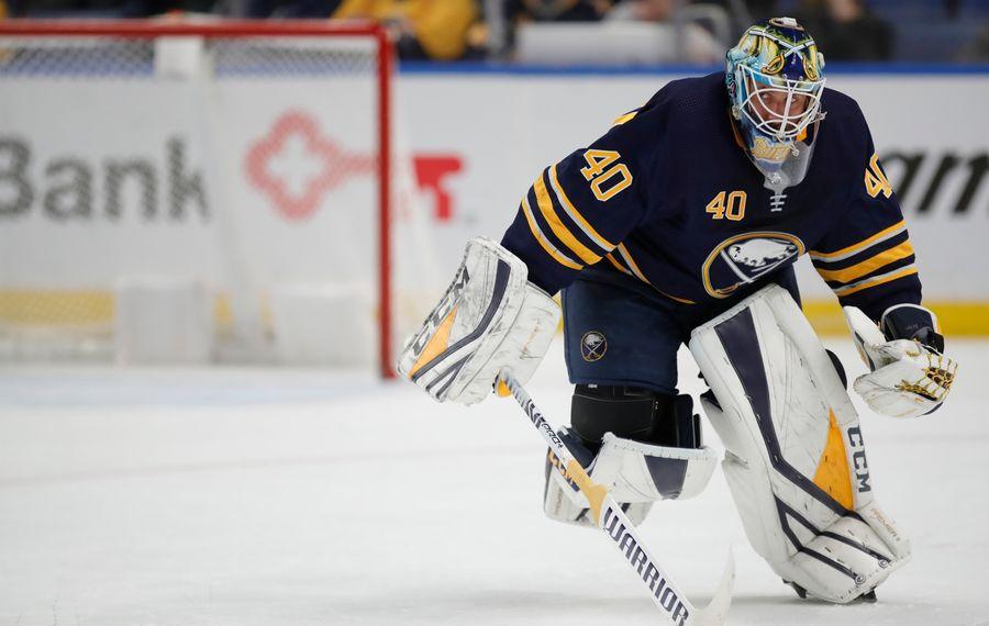 Buffalo Sabres goalie Carter Hutton skates toward the bench Tuesday night in KeyBank Center. (Harry Scull Jr./Buffalo News)