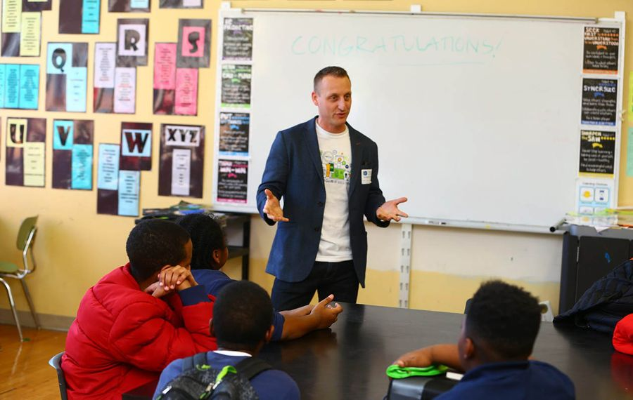 "For Chief Information Officer Michael Wisler, M&T's ""dress for your day"" policy meant wearing jeans when he went to a local school for a recent event. (John Hickey/Buffalo News)"