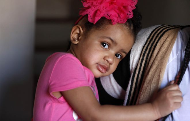 Malania Chevere, 2, suffered a critical brain injury while at a Buffalo day care. She will receive a $200,000 settlement to resolve her family's lawsuit against Mozee's Ultimate Family Daycare. (Mark Mulville/Buffalo News)