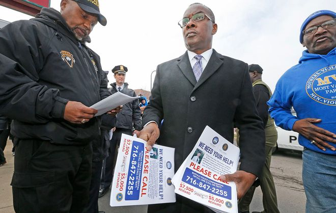 Buffalo Mayor Byron Brown handed out wanted reward posters near the Towne Gardens Plaza on Monday, April 8, 2019. (Robert Kirkham/Buffalo News)