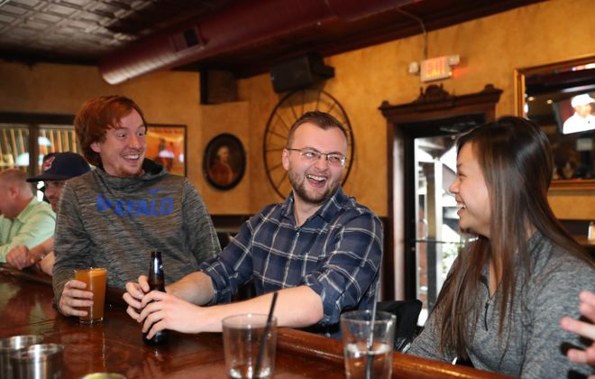 University at Buffalo  physical therapy students take a break from studying at The Steer. From left are David Brunette, of Amherst, Steven Starczewski, of Darien and Tiffany Cao, of Buffalo.  (Sharon Cantillon/Buffalo News)