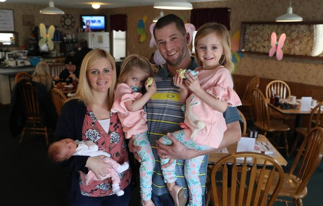 The Green family, from left, is Bridgett, holding baby Juliana, Briella, 2, Brad and Elliana, 4. (Sharon Cantillon/Buffalo News)