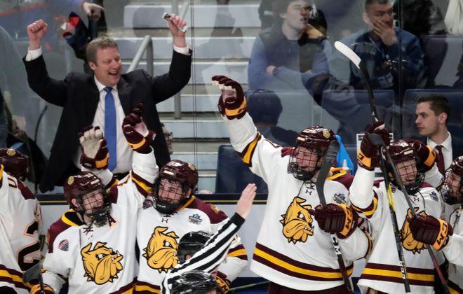 Minnesota Duluth coach Scott Sandelin celebrates an empty net goal against Providence. (Harry Scull Jr./Buffalo News)