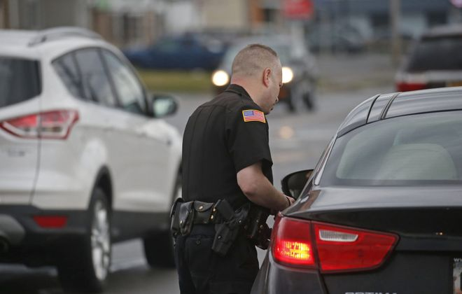 Town of Tonawanda Police Officer David Coffey says he saw this driver using her cellphone while driving on Niagara Falls Boulevard before pulling her over. Coffey said he  sometimes works a traffic enforcement shift that is focused on watching for drivers using cellphones.  (Robert Kirkham/Buffalo News)