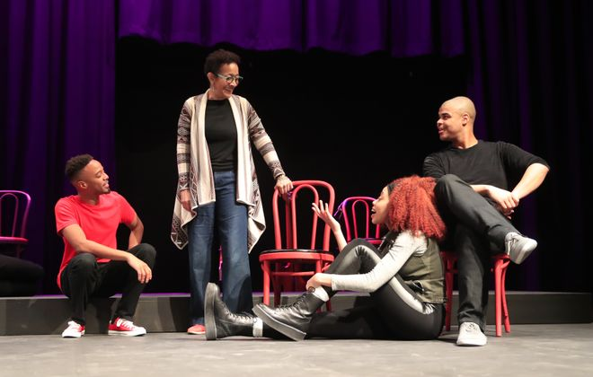 """Ujima Theatre founder and artistic director Lorna C. Hill talks with actors during a rehearsal of """"Passing Strange,"""" the first production in the company's new home.  (Harry Scull Jr./Buffalo News)"""