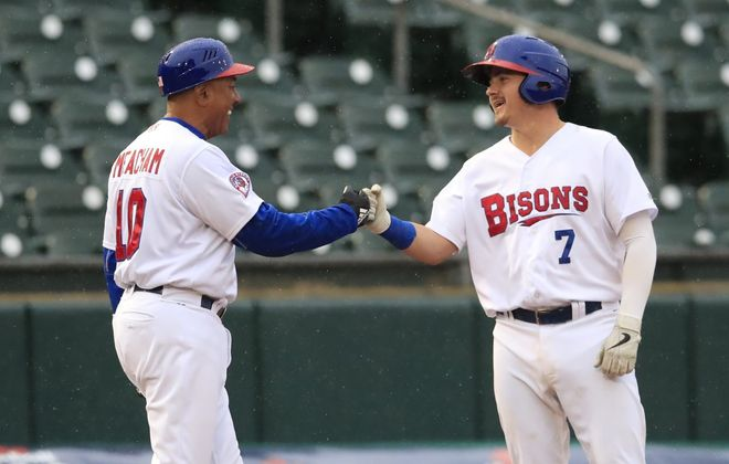 Buffalo Bisons manager Bobby Meacham congratulates Reese McGuire on his hit in the fourth inning against the Pawtucket Red Sox on Monday, April 29, 2019. (Harry Scull Jr./Buffalo News)