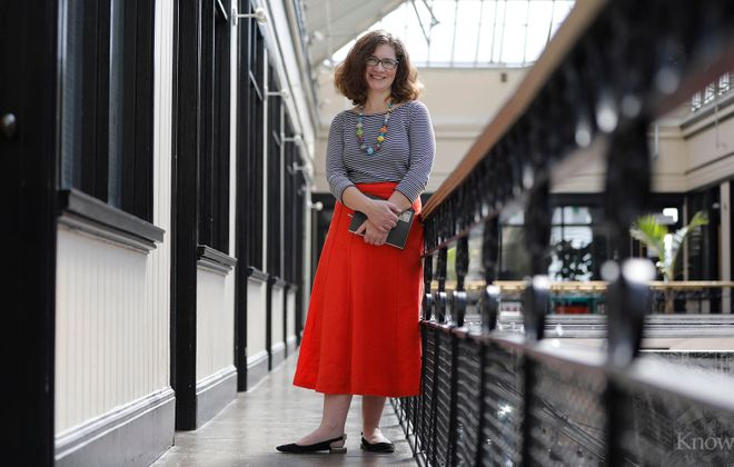 Jessie Fisher, executive director of Preservation Buffalo Niagara, was photographed for Fashion Friday at the Market Arcade on Main Street, where PBN's office is located.  (Derek Gee/Buffalo News)