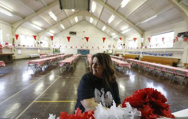 Robin Reynolds decorates the gym at the St. Casimir Social Center as she prepares for the popular Dyngus Day celebration she has helped organize for the last few years. The building used to be Bishop Ryan High School before the school closed in 1971. (Derek Gee/Buffalo News)