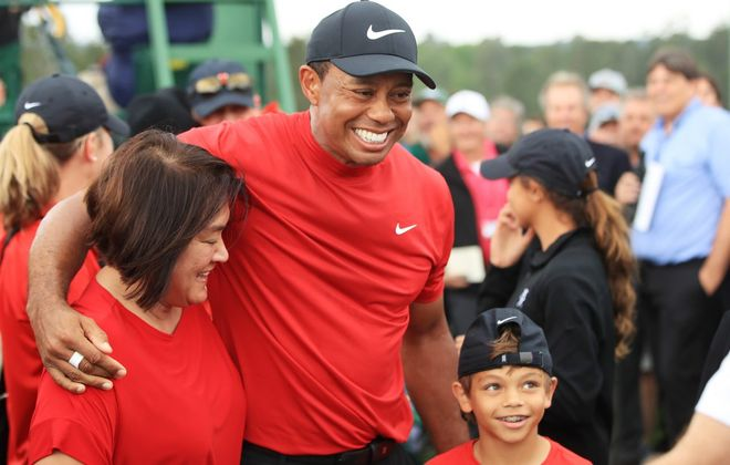 Tiger Woods celebrates with his son, Charlie Axel, as he comes off the 18th  during the final round of the Masters at Augusta National Golf Club on April 14, 2019 in Augusta, Ga. (Getty Images)
