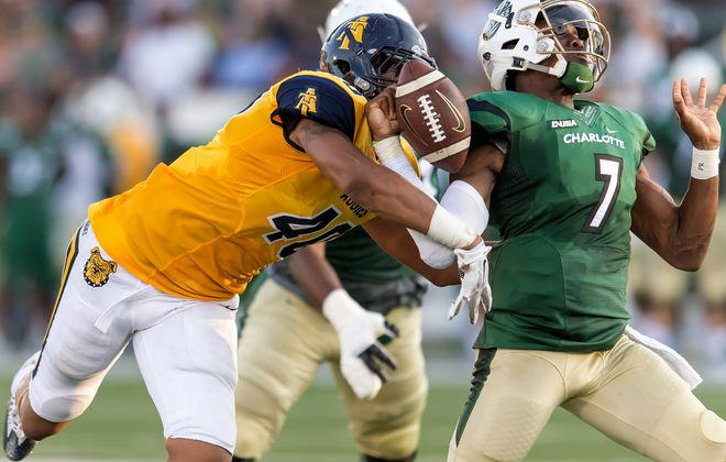 """North Carolina A&T defensive end/outside linebacker Darryl Johnson Jr., shown here against Charlotte in 2017, was described by nfl.com analyst Lance Zierlein as needing to diversify his pass-rush move. Zierlein added that Johnson brings lots of energy and is a """"voracious worker."""" (Photo by Kevin L. Dorsey/N.C.A&T)"""