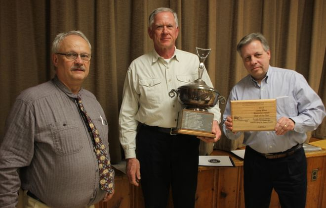 The Lake Ontario Trout and Salmon Association earned 2018 Club of the Year as the Niagara County Federation of Conservation Clubs held its awards banquet. From left, Chris Schotz, Federation President presents to Marty Polovick and LOTSA President Joe Yaeger. (Photo by Bill Hilts Jr.)