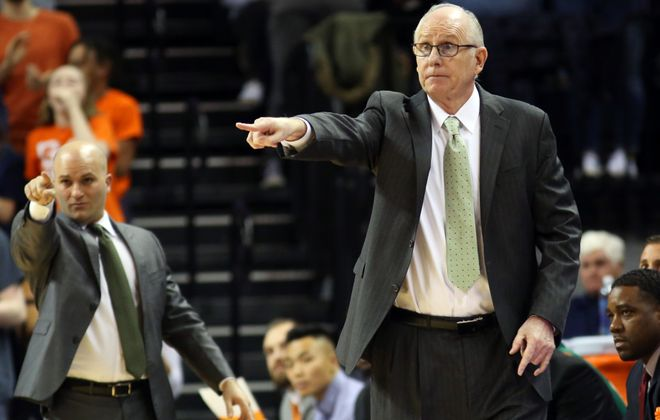 Chris Caputo (left) has been a longtime assistant to Jim Larranaga. (Getty Images)