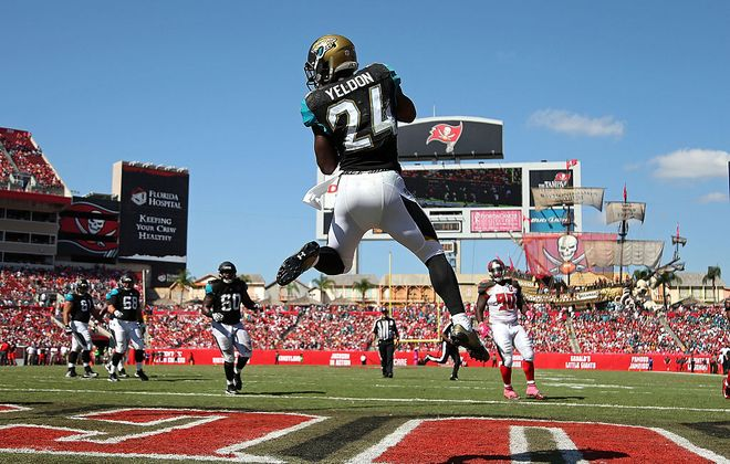 T.J. Yeldon #24 of the Jacksonville Jaguars catches a touchdown during a game against the Tampa Bay Buccaneers at Raymond James Stadium on October 11, 2015 in Tampa, Florida.  (Photo by Mike Ehrmann/Getty Images)