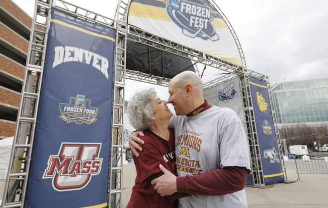 Kim and Dale Hansen of Minneapolis met during the Frozen Four college hockey championship  tournament in Buffalo in 2003. They were married later that year. They are back in Buffalo to attend the tournament again and retrace their steps. (Derek Gee/Buffalo News)