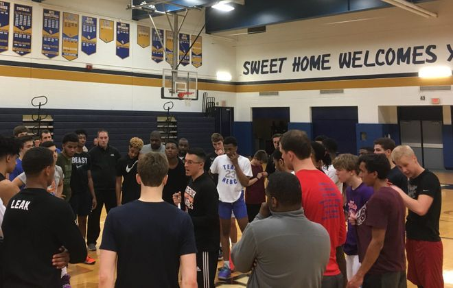 Amherst boys basketball coach Chris Kensy instructs players during Tuesday's BCANY WNY ACE All-Star Game tryouts at Sweet Home. The showcase has moved from Niagara Falls to Amherst this year. (Jonah Bronstein/Special to The News)