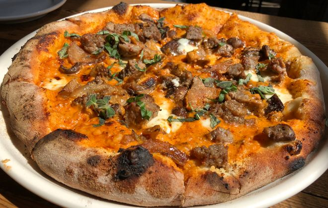 The Alla Vodka pizza, suggested by Tappo's Phil Limina, has a savory vodka sauce and ample Italian sausage. (Ben Tsujimoto/Buffalo News)
