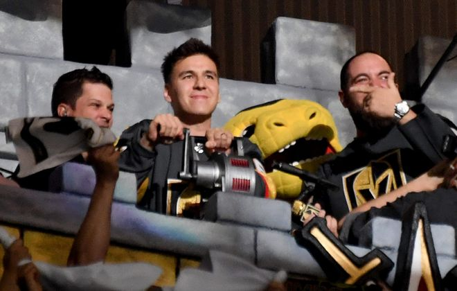 "Professional sports gambler and ""Jeopardy!"" champion James Holzhauer, center, sounds a siren before the start of Game Six of the Western Conference First Round between the San Jose Sharks and the Vegas Golden Knights during the 2019 NHL Stanley Cup Playoffs at T-Mobile Arena on April 21, 2019, in Las Vegas. (Ethan Miller/Getty Images)"