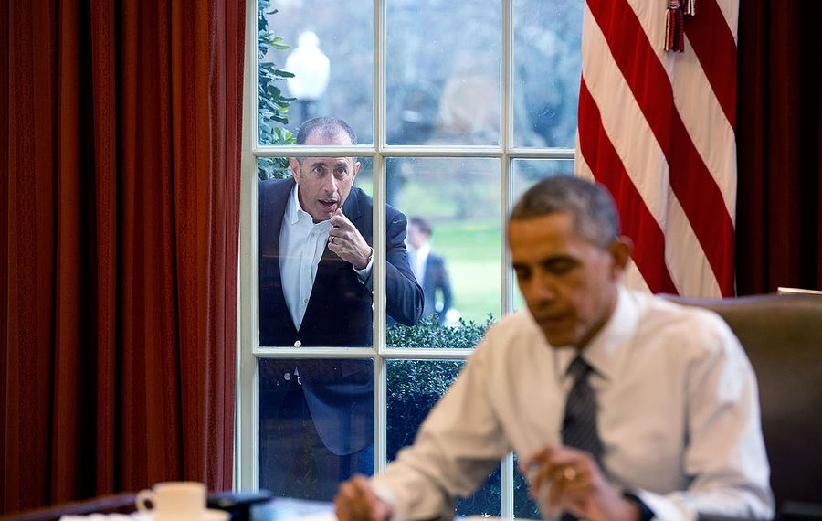 """Jerry Seinfeld knocks on the Oval Office window to begin a segment for his series, """"Comedians in Cars Getting Coffee."""" (Official White House Photo by Pete Souza)"""