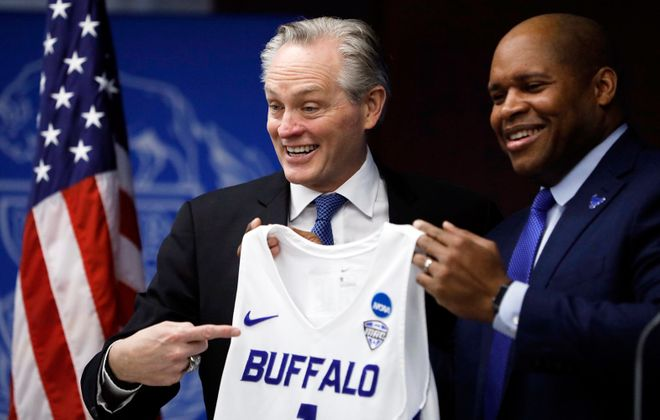 Jim Whitesell is formally introduced as the next UB men's basketball coach alongside UB Athletic Director Mark Alnutt. (Derek Gee/News file photo)