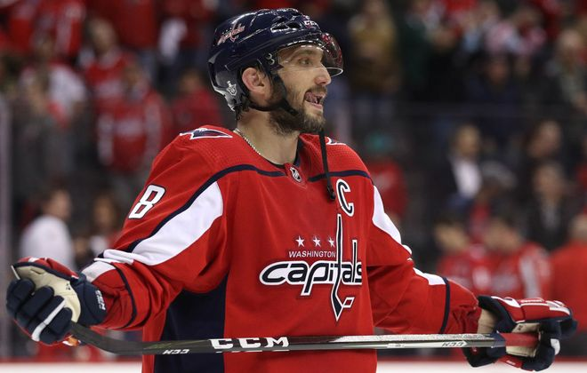 Alex Ovechkin is stunned on the ice moments after the Capitals lost their first-round series to Carolina on Brock McGinn's goal in the second overtime.(Getty Images)