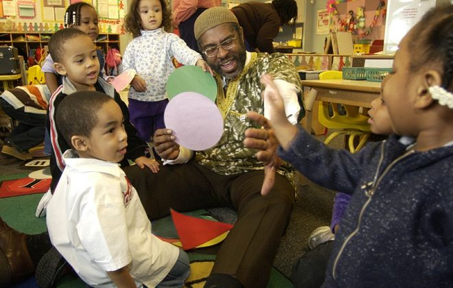 Community Action Organization Chief Executive Officer L. Nathan Hare is surrounded by  children at a Head Start program the CAO runs at Memorial Temple on  Sycamore Street in Buffalo. (Robert Kirkham/News file photo)