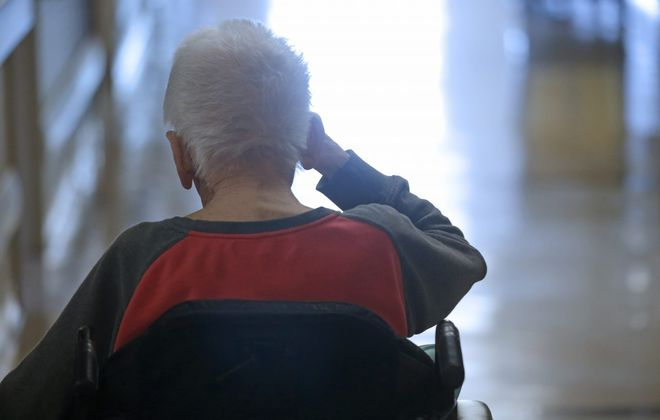 A resident makes his way back to his room in at a Buffalo area nursing home on June 6, 2018. (Robert Kirkham/News file photo)
