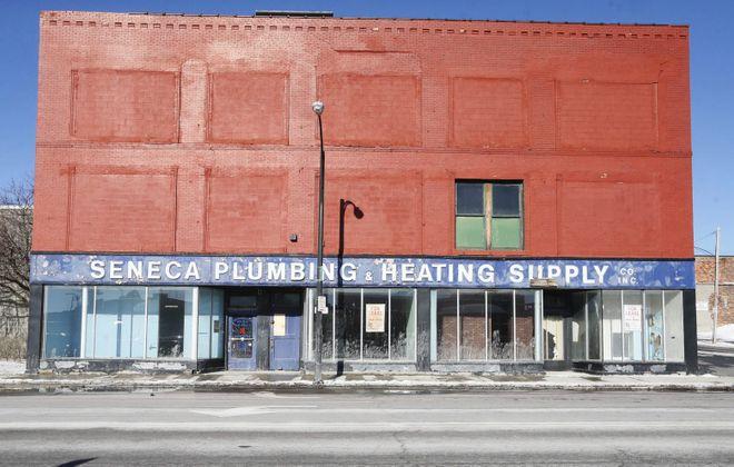 The former Seneca Plumbing and Heating building on Seneca Street in 2015.  (Derek Gee/News file photo)